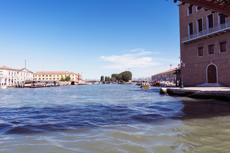 rialto: Venice, Veneto  Italy- May 20, 2017: Industrial buildings on the canal to the sea of venice Editorial
