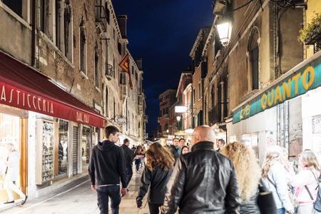 Venice, Veneto  Italy- May 20, 2017: People walking in the street called Rio Tera Lista di Espagna at dusk