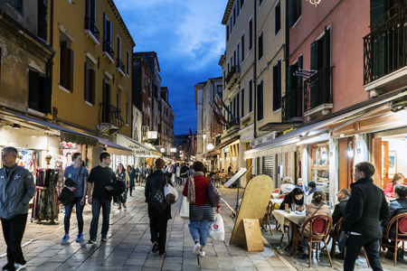 Venice, Veneto  Italy- May 20, 2017: People walking and eating in the street called Rio Tera Lista di Espagna at dusk Editorial