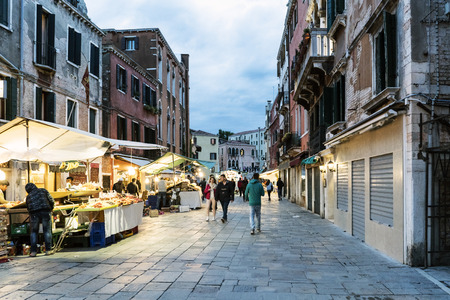 rialto: Venice, veneto  italy- May 20, 2017: People strolling at dusk on the street called Rio Tera San Leonardo and typical street stalls selling fruit
