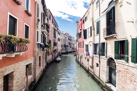 tera: Venice, Veneto  Italy- May 21, 2017: View of the canal from a bridge in the street called Rio tera Barba Futariol in the oldest part of the island of Venice. Editorial