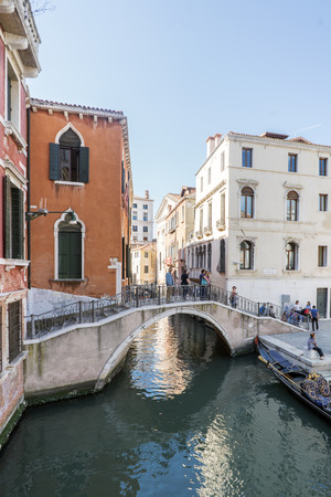 Venice, Veneto  Italy. May 21, 2017: Bridge over a very narrow canal in the square called Campo Manin Editorial