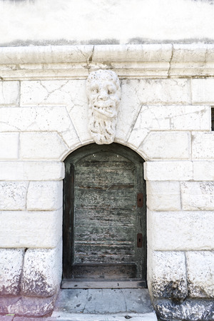 Venice, Veneto  Italy- May 21, 2017: Detail of a small door of the catholic church Santa Maria Formosa in the oldest part of the island of Venice Editorial