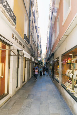 Venice, Veneto  Italy. May 21, 2017: Luxury goods stores in the narrow street called Salita S. Moise between St. Marks Square and St. Moises Square