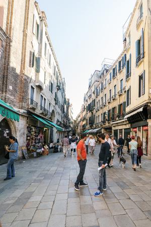 Venice, Veneto, Italy. May 21, 2017: People walking along the shopping street called Ruga del Oresi near the Rialto Bridge