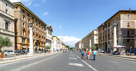 Rome, Lazio, Italy. May 25, 2017: View of the street called Via della Conciliazione in the Vatican State. With people walking and a blue sky