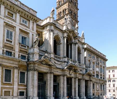 Side view Main facade of the Church called Santa Maria della Neve and also called Basilica Papale di Santa Maria Maggiore in Rome, Italy. With a clear blue sky