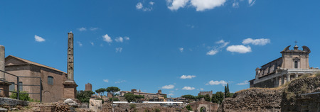 Panoramic view of the ruins of the forum of the time of the Roman Empire, with tourists visiting it Stock Photo
