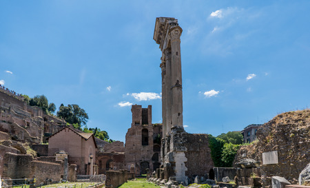 View of the various ruins of the Roman Forum with a very blue sky slightly cloudy without people in sight Editorial