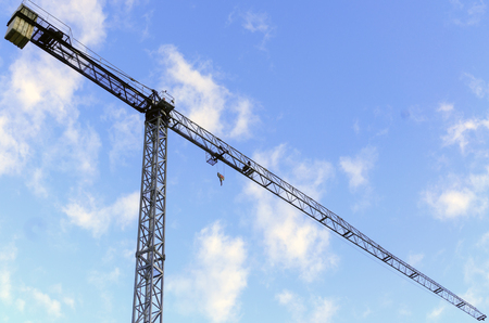 View from below of a very tall crane, prepared for the construction of buildings