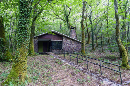 Isolated modern stone and wood country house beside the river Eume in Galicia, Spain. Zone very wooded and very green. Without people