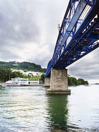 View from below of the lower part of a railway iron bridge that crosses the Eume estuary in Galicia, Spain