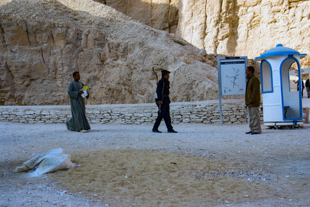 Luxor, Egypt, February 16, 2016. Police armed with rifle giving security in the Valley of kings and Arabs passing by his side