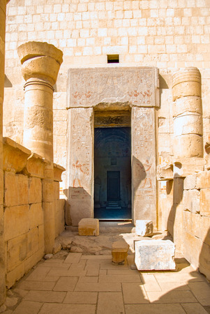 Access door to the sanctuary of Amon in the temple in honor of the pharaoh Hatshepsut called Dejeser-Djseru with many polychrome hieroglyphic paintings