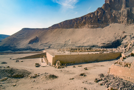 Ruins and esplanade seen from the temple in honor of the pharaoh Hatshepsut called Dejeser-Djseru, with the city of Luxor in the background. Stock Photo