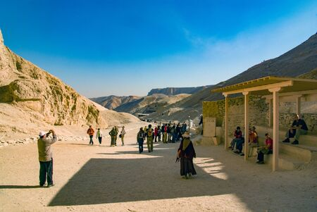 Valley of the Kings, Egypt. February 18, 2017: Tourists visiting in valley, walking, taking pictures and resting in the shade on a sunny and hot day Editorial