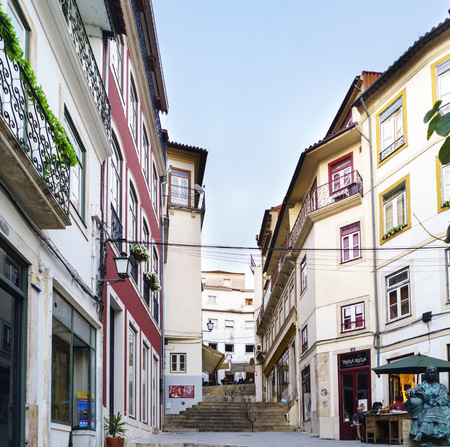 Coimbra, Portugal, August 13, 2018: Street called quebra costas (bankruptcy backs) in the old part of the city with many flights of stairs and shops and typical bars in the oldest part of Coimbra