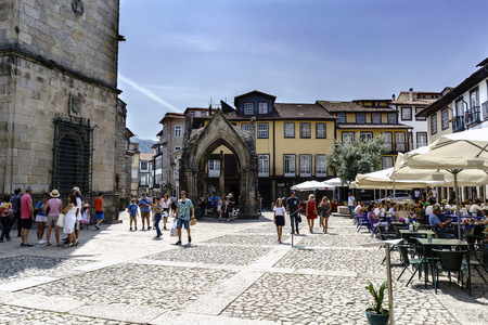Guimaraes, Braga, Portugal. August 14, 2017: small Gothic-style temple from the 14th century in the center of the town that commemorates the battle of the Salado against the Arabs. With many tourists strolling and bar terraces