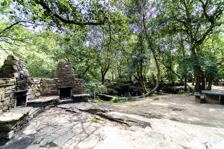 Snack area with stone barbecues and tables and benches for picnics in a glade of a typical Atlantic forest in Galicia, Spain Stock fotó