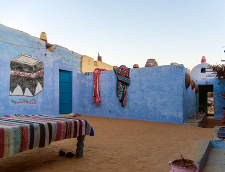 Cairo, Egypt February 18, 2017: Partial view of the central patio of a Nubian house painted blue and with drawings in a village near Cairo