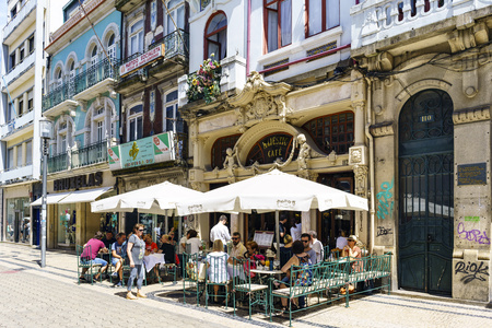 Porto, Portugal. August 12, 2017: Historic cafe called Majestic on the street called Santa Catarina with people sitting on its terraces