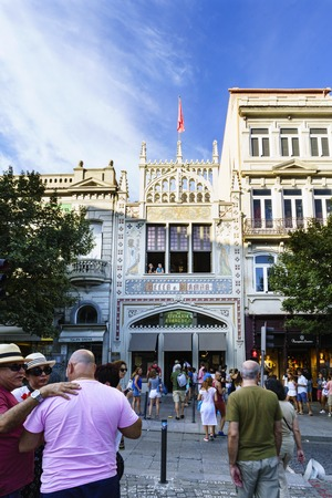 Porto, Portugal. August 12, 2017: The library called Lello facade where J. K. Rowling was inspired for the diagon alley bookstore, with many tourists visiting it and houses around