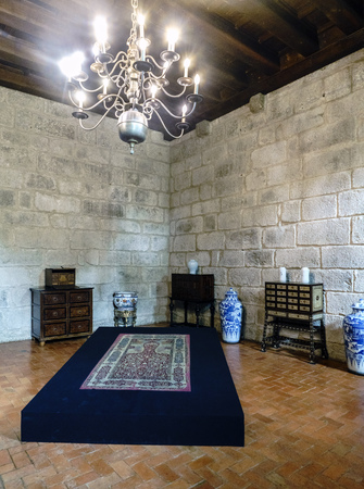 Guimaraes, Portugal. August 14, 2017: Display of desks with medieval drawers and china vases in a room of the palace of the Dukes of Braganza Editorial