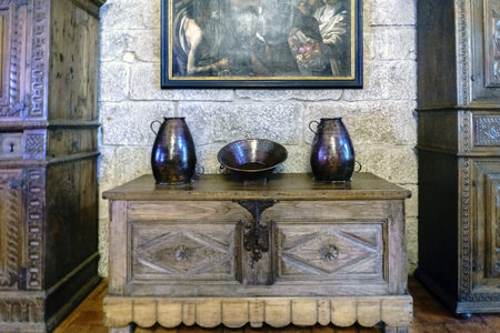 Guimaraes, Portugal. August 14, 2017: Medieval wooden bargueño with ornaments of copper