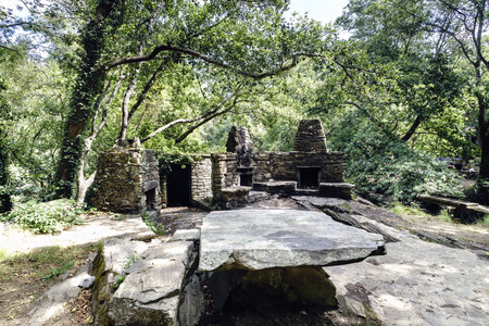 Snack area with stone barbecues and tables and benches for picnics in a glade of a typical Atlantic forest in Galicia, Spain 写真素材