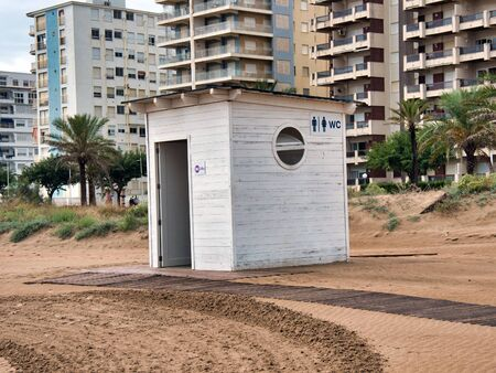 Wooden toilet house on the beach of Gandia, Valencia in a rainy and rainy day