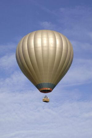 Golden Hot air balloon in blue skly Stock Photo