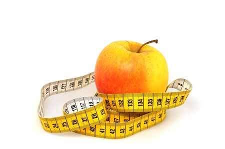 wellbeeing: Apple and tape measure as symbol for healthy lifestyle