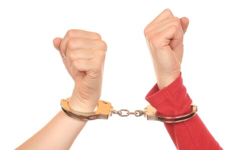 captivated: Arms of two young women connected with handcuffs Stock Photo