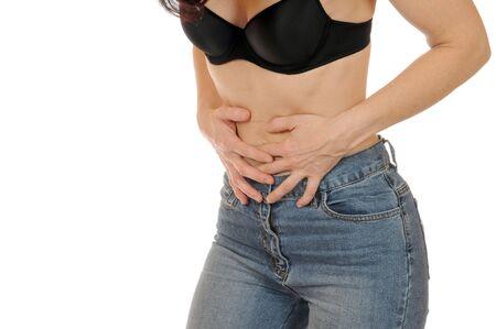 abdominal pain: Slim giovane donna ha dolori addominali