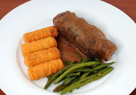 Roulade with beans and croquettes photo