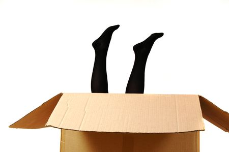 young girl, dressed with black tights, in a box photo