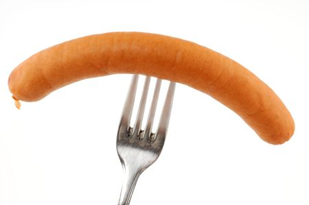 Wiener on a fork in front of a white background
