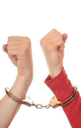 Arms of two young women connected with handcuffs photo
