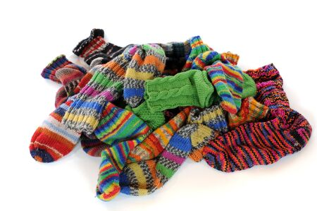 Pile of multicolored socks as laundry photo