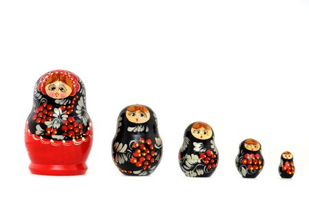 Russian Matryoshka doll in front of a white background photo