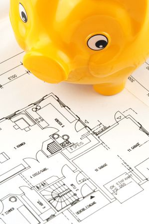 Piggy bank and blueprint  photo