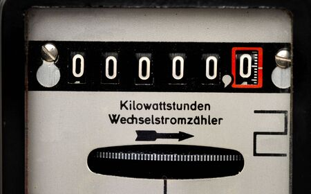 Old electricity meter in front of a white background Standard-Bild