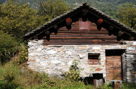 Old house in Swiss alpes photo