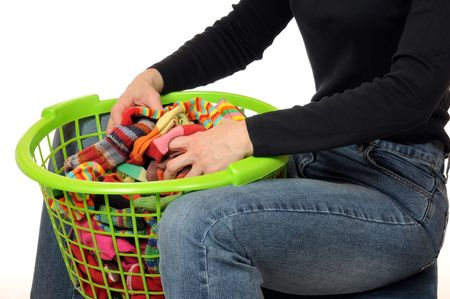 farbe: Young woman with a laundry basket full of socks