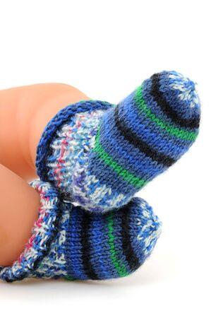 Multicolored wool-socks on white background photo