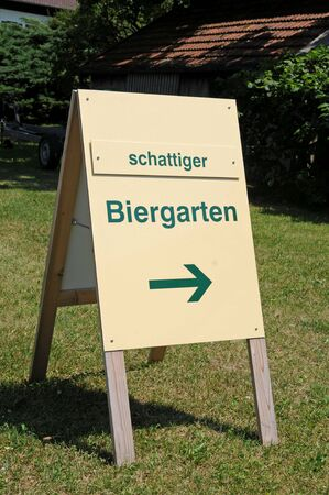 snugly: Sign for a beer garden in the shadow in Bavaria Stock Photo