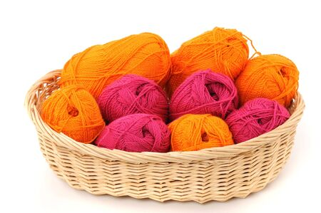 basket embroidery: Multicolored wool in a basket on white background