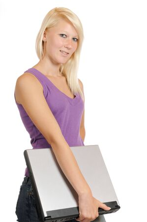 Young girl with laptop in front of a white studio background photo