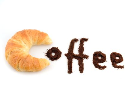 Light croissant with coffee powder in front of a white background