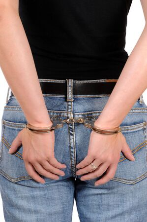 Hand of a young woman in handcuffs Stock Photo - 5620941
